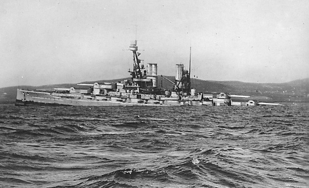 "No. 2 German battleship ""Bayern"" sinking by the stern. Photo taken 2 p.m., 21-6-1919 ""Bayern"" was salvaged September 1933. This series of postcards seems to have been made by C. W. Burrows to record the scuttling of the German fleet at Scapa Flow in 1919."
