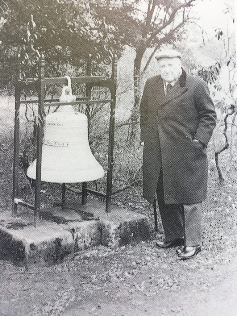 Bob McCrone seen with the salvaged bell of SMS König Albert.