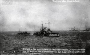 A re-enactment of the stand-off in the Schilling roads, shows SMS Thüringen threatened by two destroyers and a submarine.