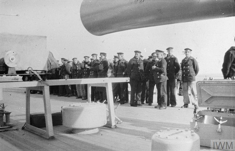 SURRENDER AND SCUTTLING OF THE GERMAN FLEET AT SCAPA FLOW, NOVEMBER 1918 - JUNE 1919 (SP 1226) Scuttling of the German Fleet at Scapa Flow: German prisoners from scuttled ships on the quarter-deck of HMS RAMILLIES. Copyright: © IWM. Original Source: http://www.iwm.org.uk/collections/item/object/205193808